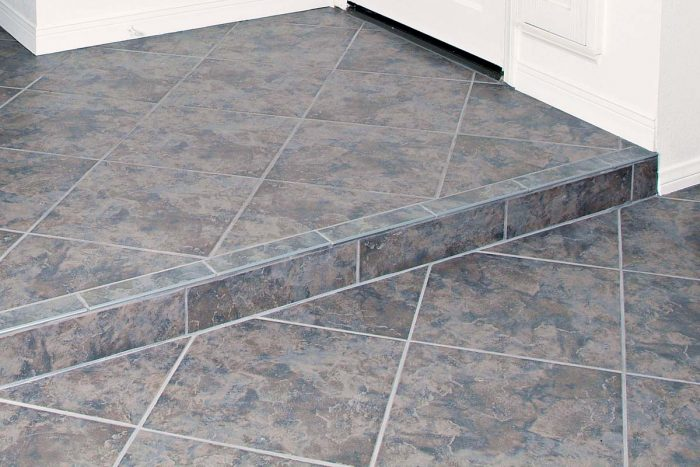 Careful layout ensures that the rows of diagonally set tile and the grout joints line up all the way across the floor