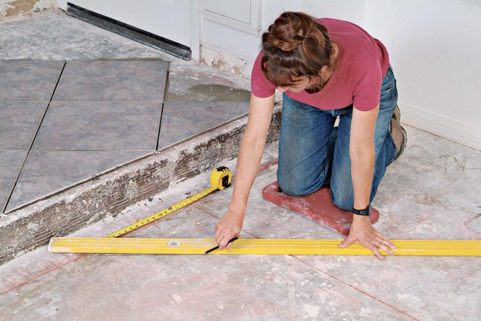 The layout lines keep the rows of tile running at a perfect 45° angle to the step.