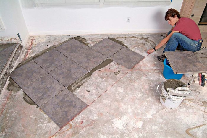 Additional chalklines serve as a guide to keep subsequent rows of tile straight.
