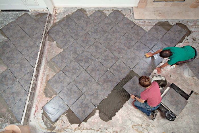We set only full tiles across the floor; the cut tiles will be set the next day.