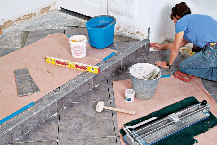 The step is tiled with a bullnose edge on top and a cut tile on the face of the riser.