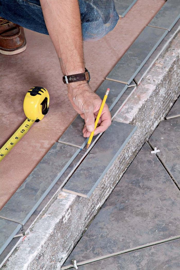 Use the center of the entry layout to determine the best layout pattern for the bullnose step trim.