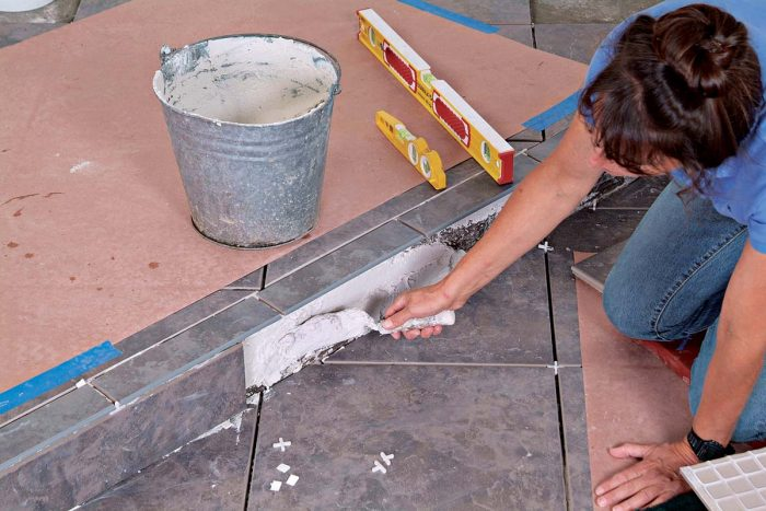 Add extra thinset to fill out voids behind the cut tiles that cover the face of the riser.