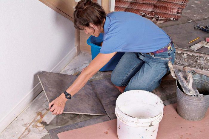 Carefully lay the back-buttered cut tile in place, aligning and leveling it relative to the adjacent tiles.