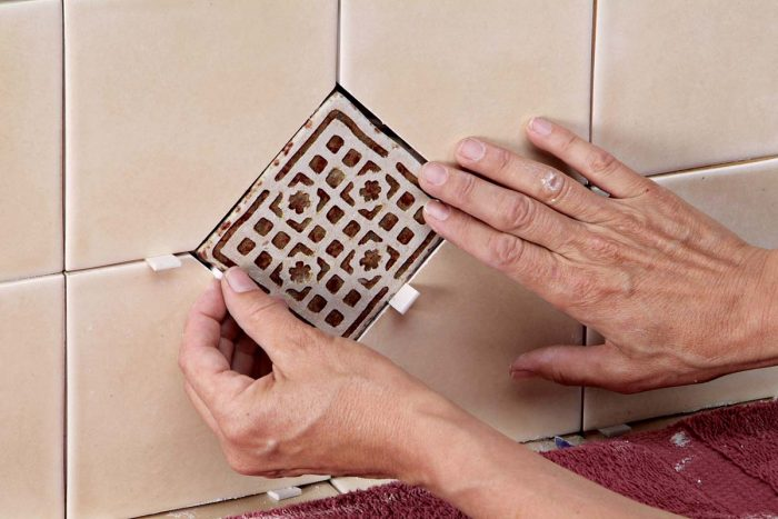 Wedges help keep an even grout joint around each decorative tile.