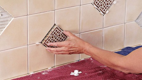 Set the deco tiles into your backsplash while the thinset is still pliable.