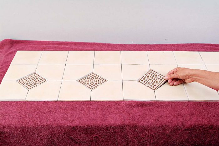 Decide on the layout for any decorative tile or trim.