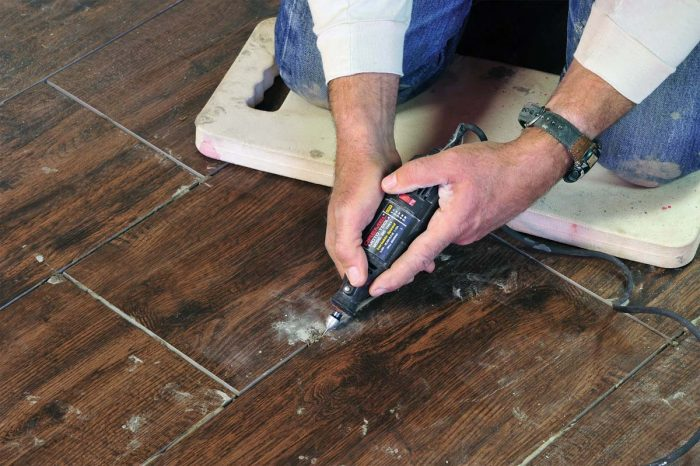 When cured thinset is too hard, you may wish to use a rotary saw with a grout removal bit. Steady hands are a necessity!