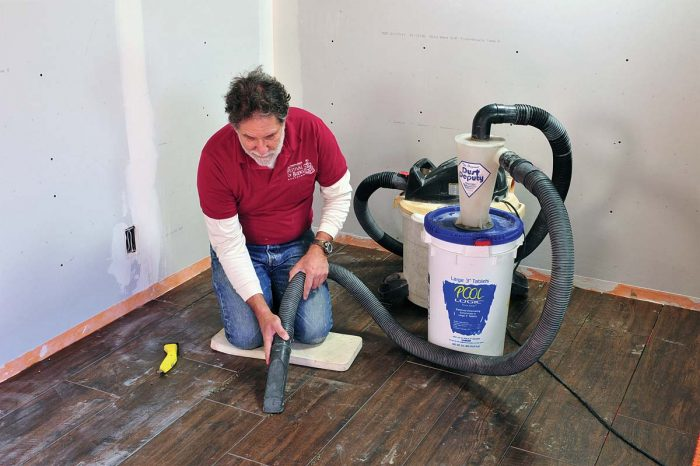 Vacuum up all loose material from the joints and surrounding area.