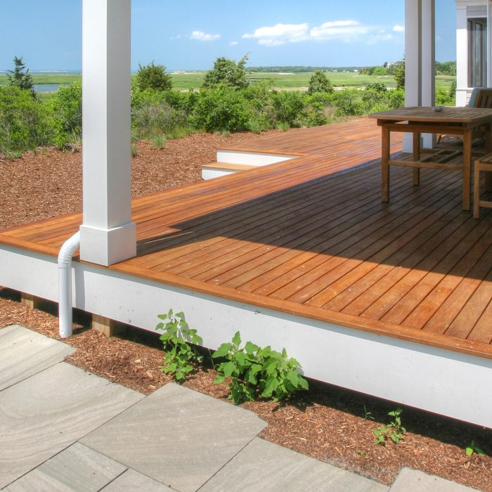 A brown deck with white trim and columns
