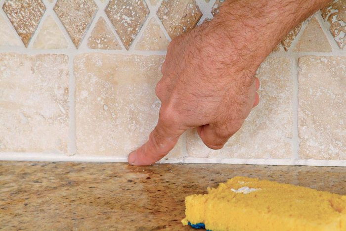 Use a damp finger to smooth and shape the caulk joint.