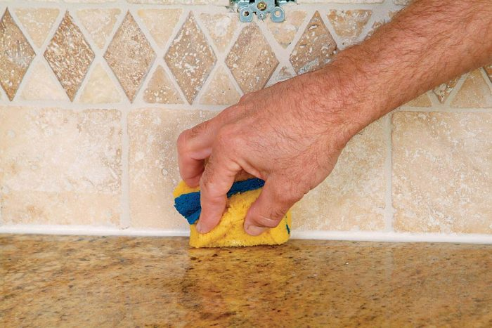 Use a damp noncellulose or shed-free sponge to remove caulk residue.
