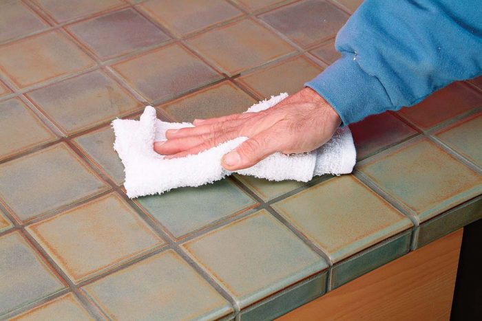Sealer will penetrate through the grout. Wipe any excess sealer from the face of the tile.