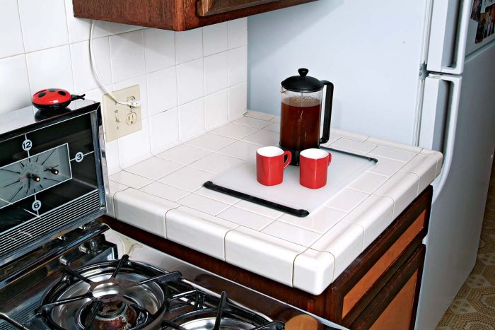 A cutting board or mat will save wear and tear on your countertop and catch errant drops or spills.