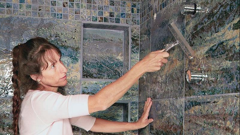 Using a squeegee or towel to wipe down your tiled walls after showering helps prevent mildew.