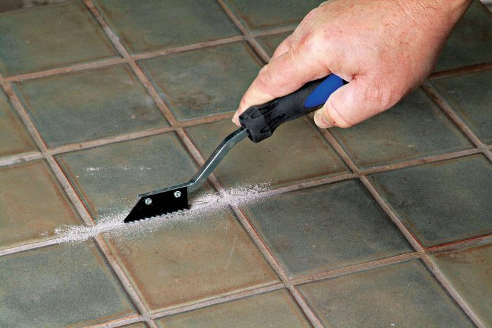 A hand-held carbide grout saw can be used to remove grout around a cracked or chipped tile.