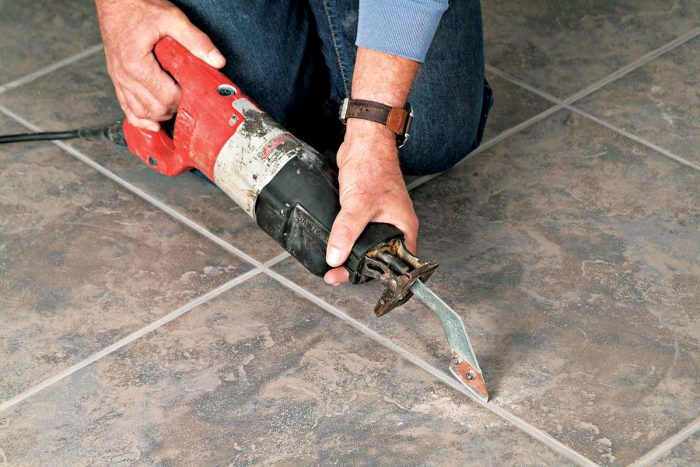 A carbide grout blade attached to your reciprocating saw quickly removes grout from around tiles.