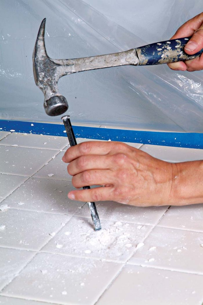 Use the chisel to remove small fragments of tile.