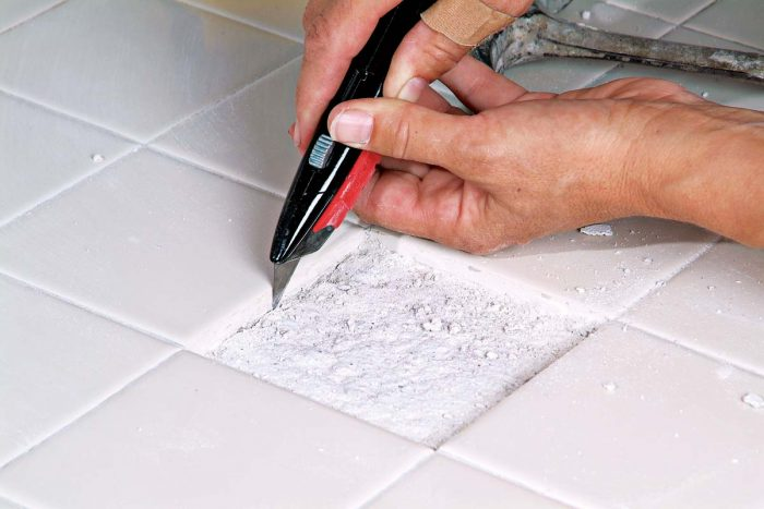 Use a razor knife to remove any remaining grout with caution. The cleaner the area, the easier it will be to fit the new tile.