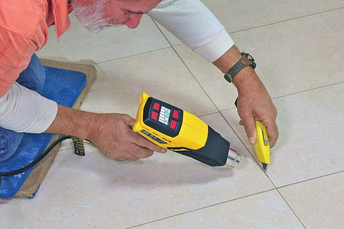 To replace a tile grouted with epoxy grout, you'll first need to soften the grout with a heat gun. It can then be scraped out with a utility knife.