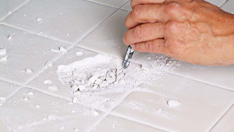 Hammer and chisel out the remaining parts of the tile with great care.