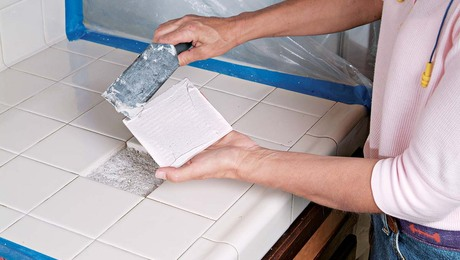 Apply thinset to the back of your replacement tile, especially the corners.