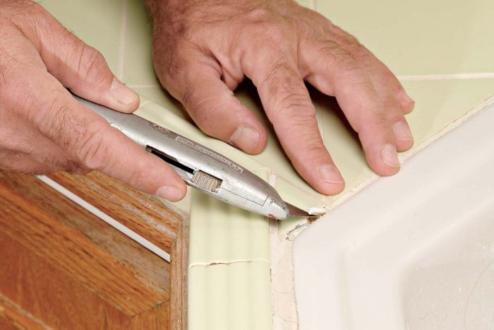 Check for any loose grout and lift it out carefully.