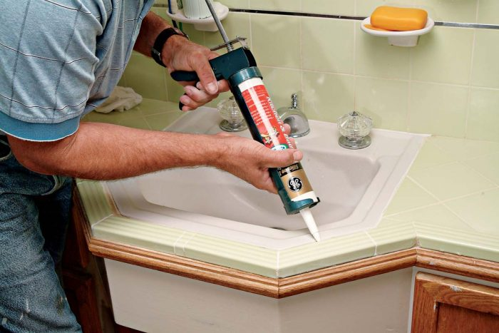 Caulk any areas that typically experience movement, as between sink and tile.