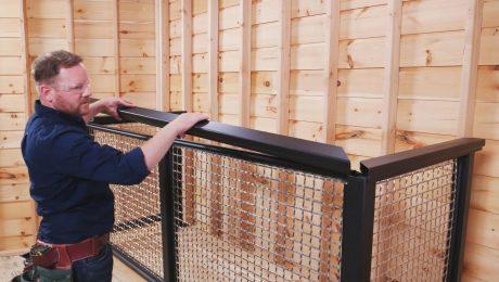 A man installing a metail guard rail