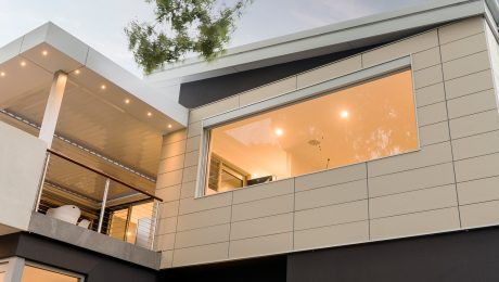 Beige ceramic tiles on the side of a modern house