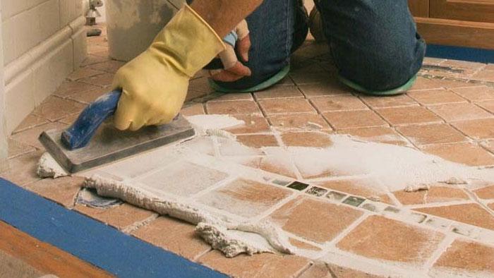 grouting tile floor