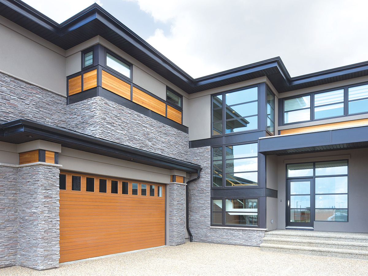 modern home with insulated wooden garage door