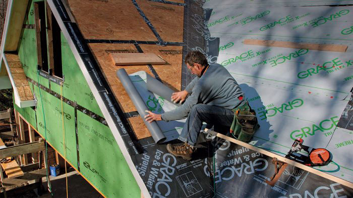 Installing underlayment on a roof