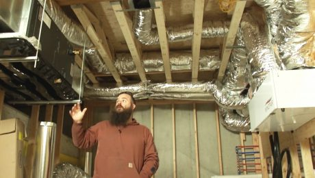 Ben Bogie in a room with HVAC equipment