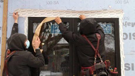 Flashing windows over self-adhered housewrap