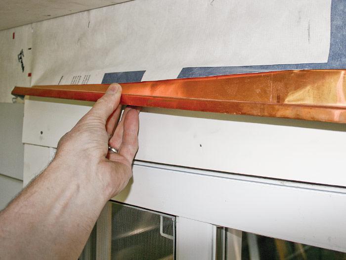 Install metal drip cap