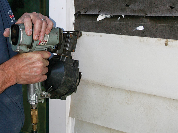 install fiber-cement siding with a pneumatic nailer