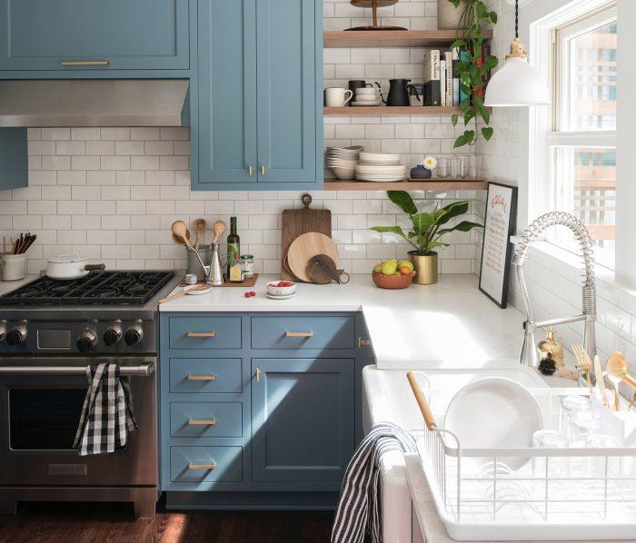 Metallic pulls on a blue kitchen cabinets