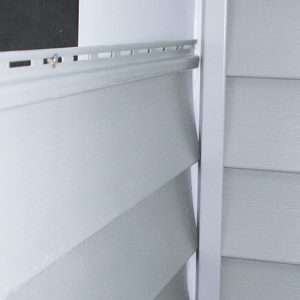 slip each siding panel behind the J-channel