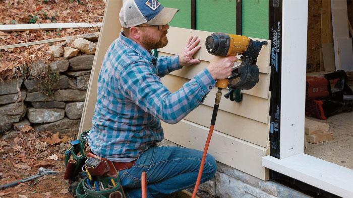 nailing new clapboard siding