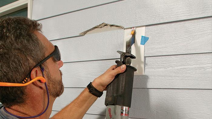 remove broken clapboard siding