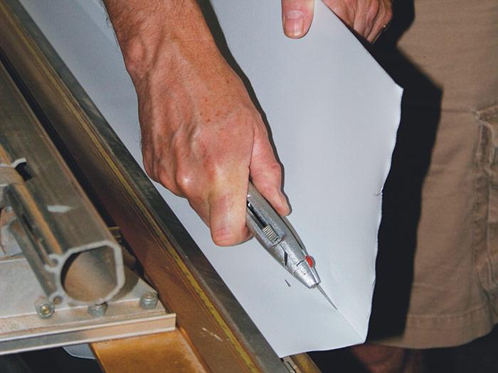 Reclamp and score the aluminum sheet metal
