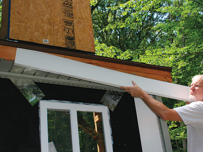 Slip the cut and formed piece of aluminum fascia