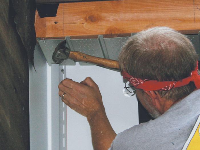install J-channels before installing vinyl siding panels