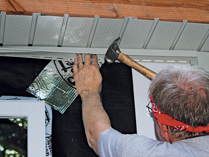 Nail J-channel directly below the soffit