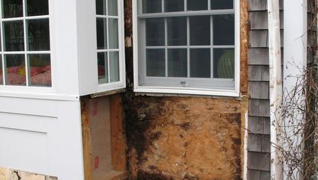 Rotten wall sheathing due to cap flashing leak