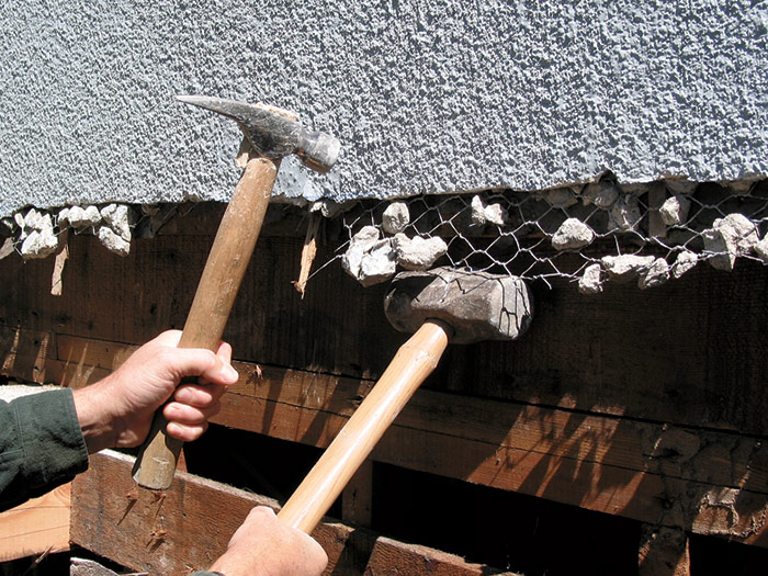 remove stubborn chunks of old stucco from the wire mesh
