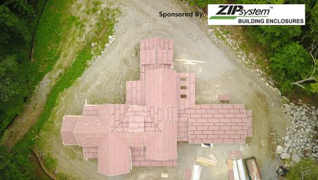 An aerial view of a large house with the ZIp system logo in the corner