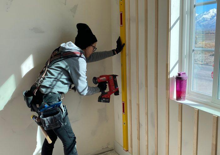 woman installing interior board-and-batten walls