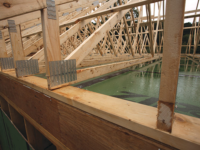 set the trusses on a 2x6 plate on top of the Zip air-seal